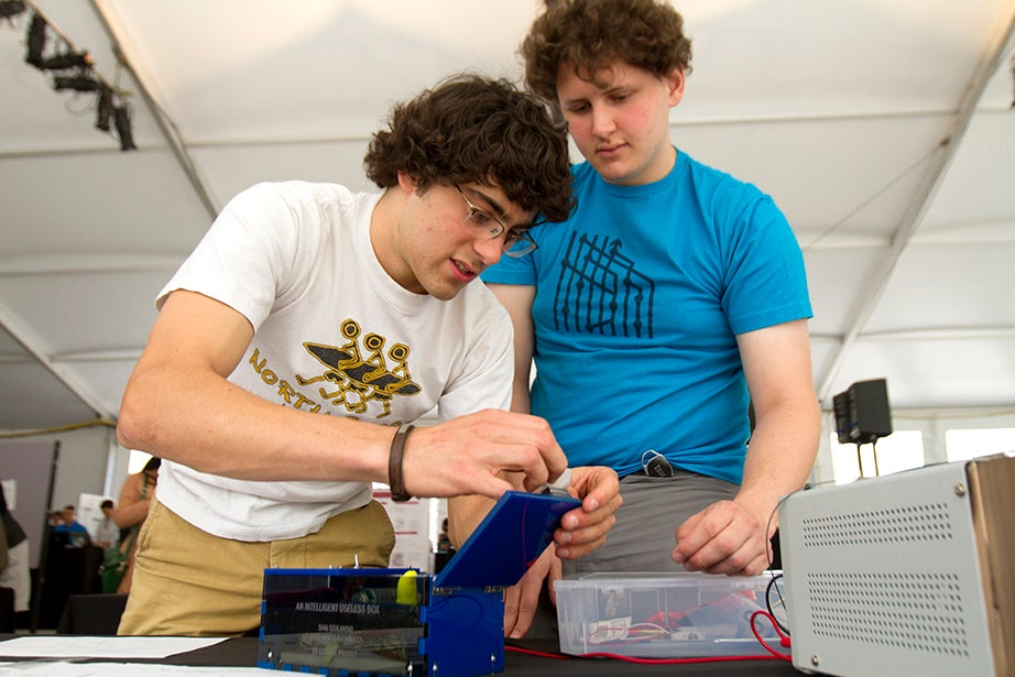 Akeo Maifield-Carucci '15 (left) and Shai Szulanski '17 make adjustments to their product.