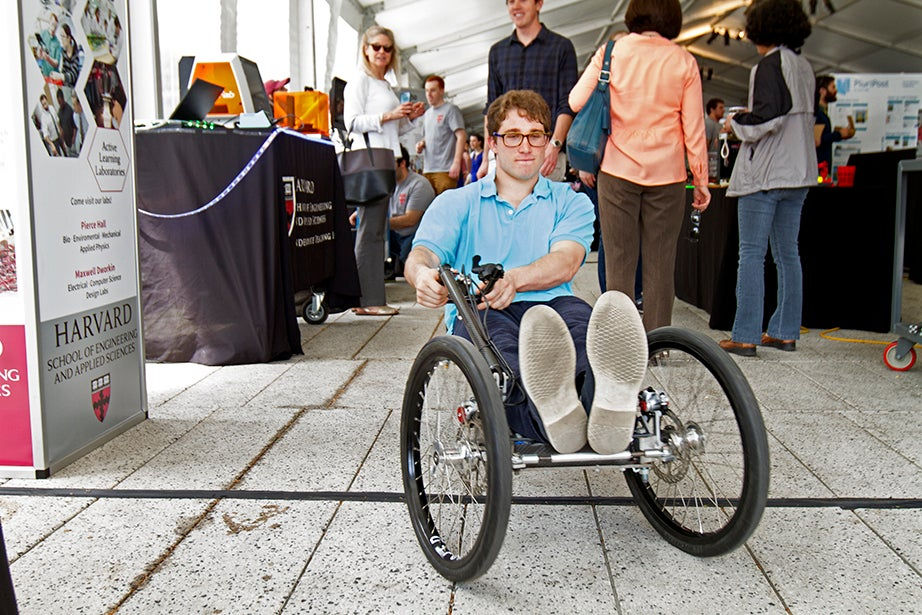 Joe Pappas '17 rides the Crimson Cruiser, a lightweight go-kart designed to run on minimal electrical energy.