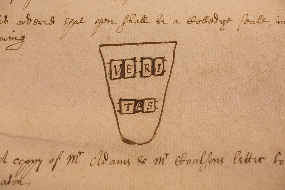 A proposed design for the original Veritas shield, drawn on page 27 of College Book I, the Harvard Corporation's earliest records, in an entry from Dec. 27, 1643.
