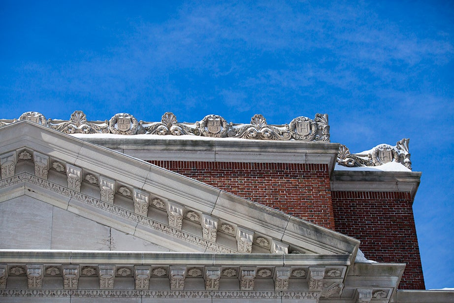 Along the north roofline of Widener Library.