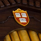 Harvard University has veritas shields on display in every corner of the campus. A veritas shield is pictured above the organ in Memorial Church. Stephanie Mitchell/Harvard Staff Photographer