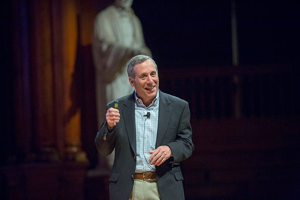 """Lawrence S. Bacow, J.D. '76, M.P.P. '76, Ph.D. '78, delivered a talk titled """"Online Learning: The Scourge or Savior of Higher Education"""" at Sanders Theatre on Thursday at the start of the Harvard IT Summit."""