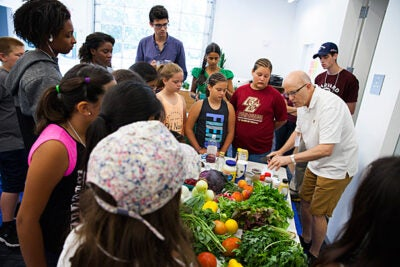 """The annual """"Science and Cooking for Kids"""" program brought former White House pastry chef Bill Yosses (left) back to campus to teach students various cooking techniques and how to connect food with math and science."""
