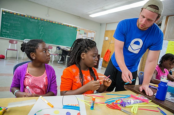 Luke Roberts '16 (from right) works with Fabienne Douyon and Adrianna Brown, both fifth-graders at Benjamin Banneker Charter Public School in Cambridge, as part of  PBHA's Cambridge Youth Enrichment Program.