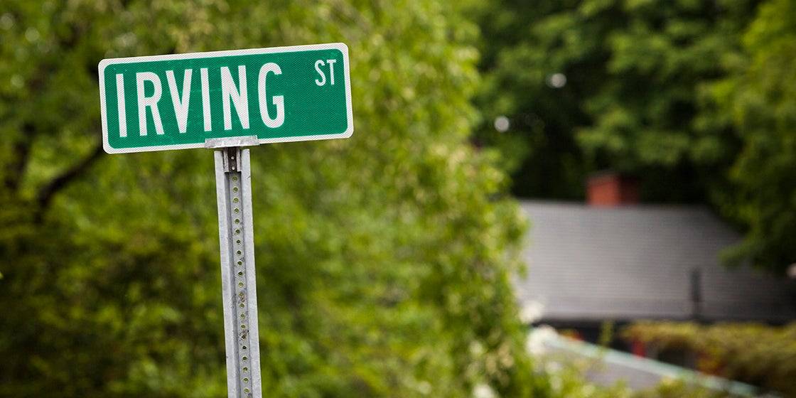 View of the sign that marks storied Irving Street in Cambridge. William James, e.e. cummings, Julia Child, Marion and Arthur Schlesinger, Jr., Martin Karplus, and Gerald Holton are among the many notable residents that have called Irving Street home. Stephanie Mitchell/Harvard Staff Photographer