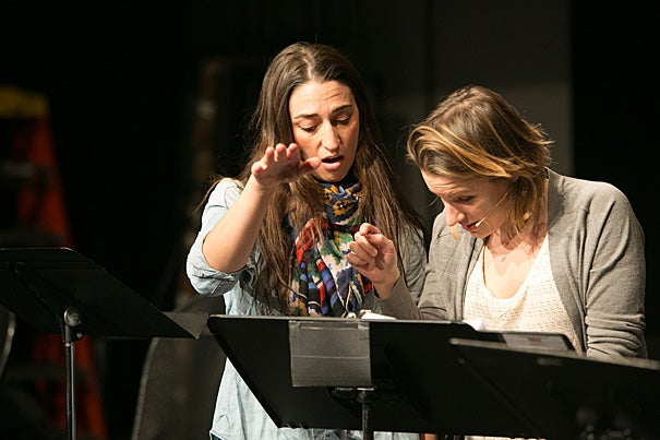 """Singer-songwriter Sara Bareilles (left, photo 1) is behind the music and lyrics for the American Repertory Theater's new musical, """"Waitress."""" Jeanna de Waal and Jeremy Morse (photo 2) rehearse for the production, which is directed by Diane Paulus (photo 3), pictured here with set designer Scott Pask."""