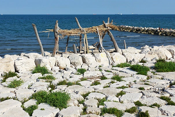 "Makeshift shelters made of recycling and natural materials dot the piers on the Adriatic side of Lido Beach, Italy (photo 1). All the community asks is that other people ""tenere pulito,"" or keep clean, said James Voorhies, John R. and Barbara Robinson Family Director of the Carpenter Center. Currently in Venice, he snapped this image of the video and installation titled ""Factory of the Sun"" by Hito Steyerl in the German pavilion at the Venice Biennale (photo 2). Before Italy, Voorhies spent time in Berlin, where he visited Park Gleisdreieck (photo 3), a former industrial and rail yard site recently transformed into a park and public space."
