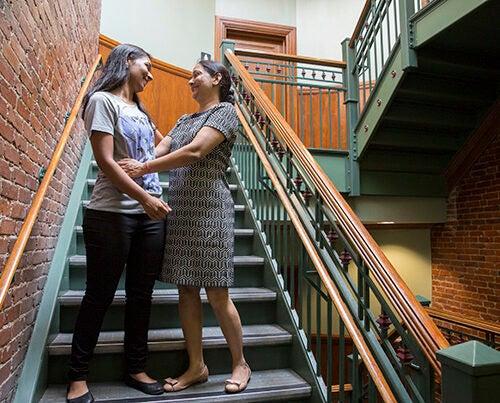 Saloni Vishwakarma '19 moves into Matthews Hall with the help of her mother, Rekha Vishwakarma. Kris Snibbe/Harvard Staff Photographer