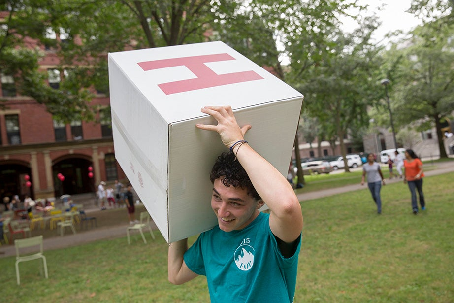 William Belfiore '19 carries a Harvard-labeled box stuffed with linens. Kris Snibbe/Harvard Staff Photographer