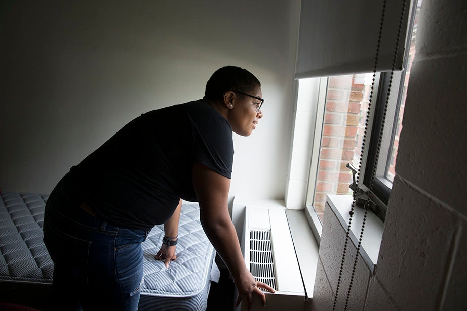 Soraya Shockley scopes out the view from her Canaday Hall digs. Rose Lincoln/Harvard Staff Photographer
