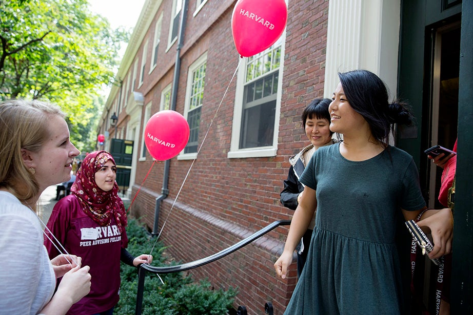 Julia Cataldo '15 and Fatima Bishtawi '17 help Hyung Suk Choi '19 move into Wigglesworth Hall. Kris Snibbe/Harvard Staff Photographer