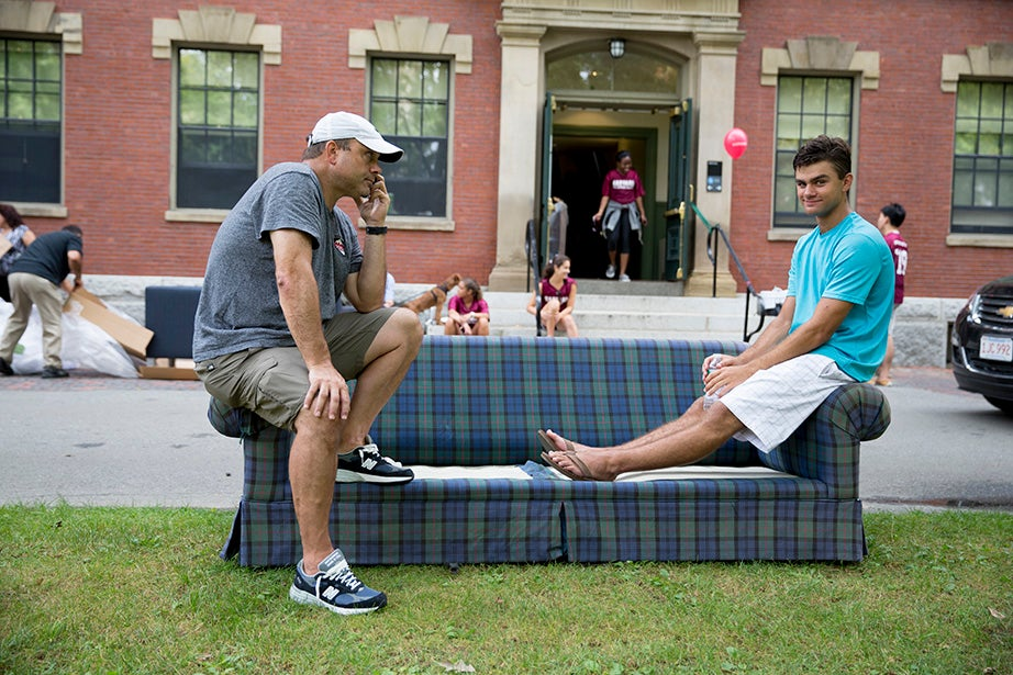 Peter and Cameron Chiarelli '19 (right) move a couch into Thayer Hall. Rose Lincoln/Harvard Staff Photographer