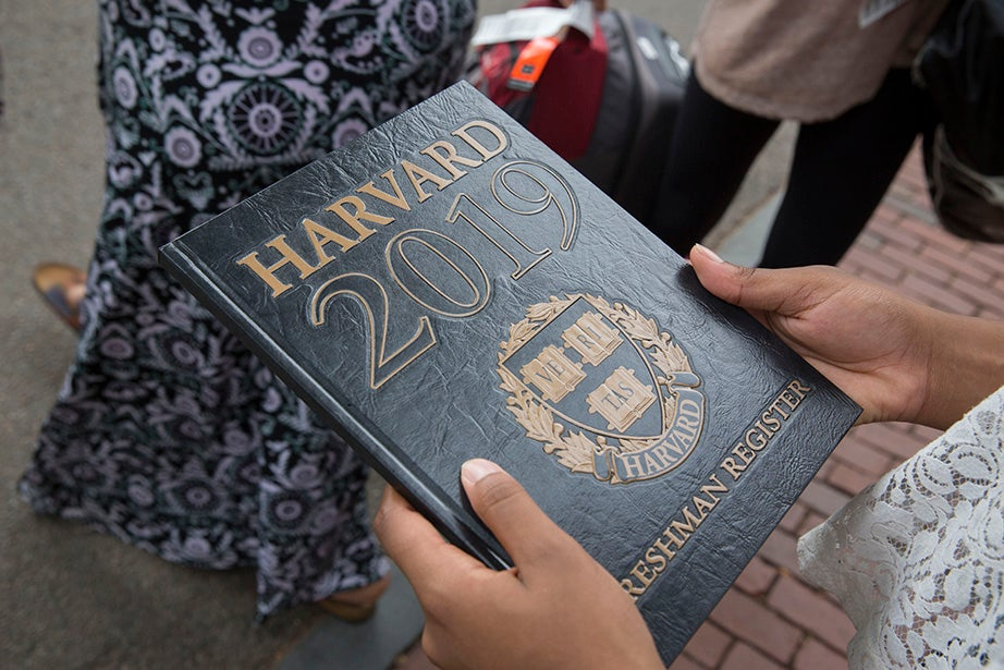 Angelica Chima '19 holds a freshman register as she moves into Matthews Hall. Kris Snibbe/Harvard Staff Photographer