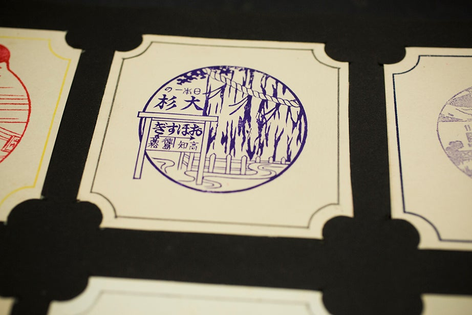 Multihued inked stamp prints show travel, landscapes, and activities.