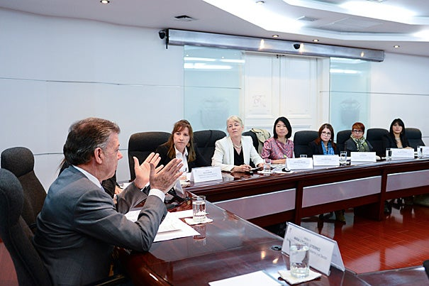 A Harvard report on Colombia's reparations program caught the eye of President Juan Manuel Santos, who asked Kathryn Sikkink and Phuong Pham (second and third from left) to present their findings. Douglas Johnson, director of the Carr Center for Human Rights Policy, was the third member of the fact-finding team.