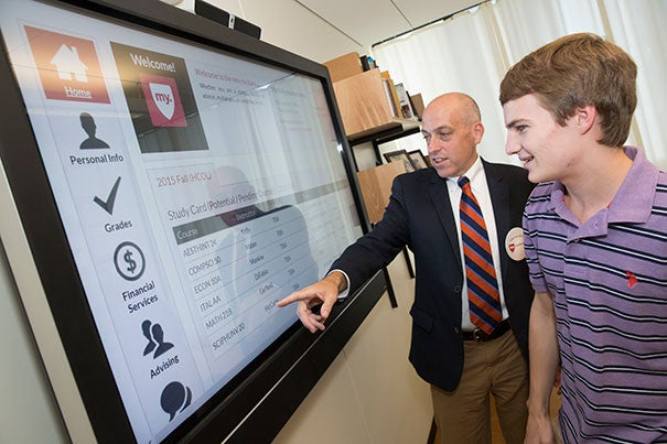 """""""We've brought it all under one portal,"""" said Faculty of Arts and Sciences Registrar Michael Burke, showing student intern Bennett Parsons '18 the new my.harvard website."""