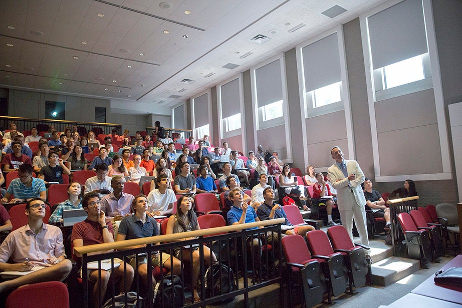 Edward Glaeser moves through the room during his seminar. Kris Snibbe/Harvard Staff Photographer