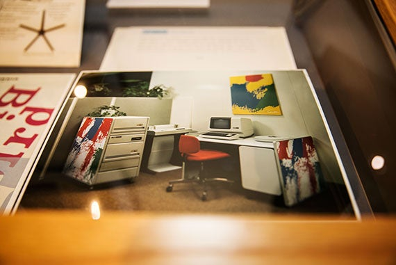 A photo in the Schlesinger Library exhibit shows how the Corita Kent prints commissioned by Digital Equipment Corp. were to be used to decorate the company's hulking minicomputers. Kris Snibbe/Harvard Staff Photographer