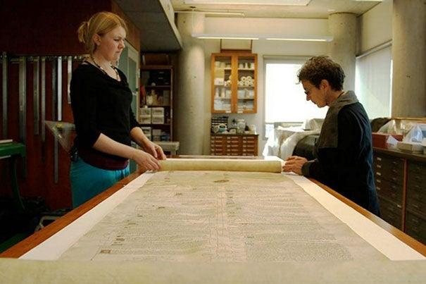"""Students taking """"The Book,"""" a modular MOOC developed through HarvardX, will get unprecedented digital access to Harvard's archives of printed material. Among the holdings is a 39-inch scroll from the 15th century (photo 1). The course was conceived by Professor Jeffrey Hamburger (photo 2). Professor  Ann Blair (right, photo 3) and Meredith Quinn are filmed during a segment on Islamic manuscripts."""