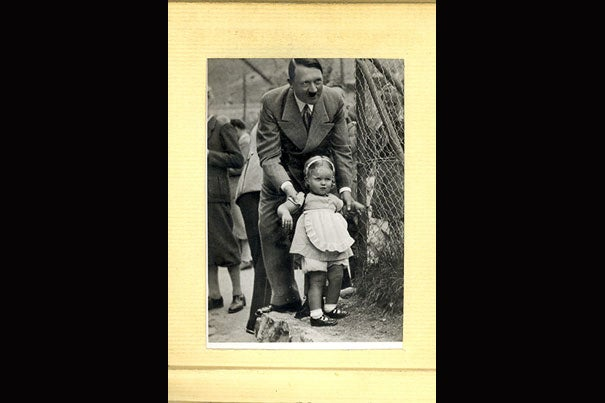A German photo album featuring Adolf Hitler with children (photo 1) is part of a donation from the José María Castañé Foundation and was in a summer exhibit at Houghton Library. Leslie Morris (photo 2), curator of modern books and manuscripts at Houghton Library, said the material will give scholars interested in 20th-century history a hint of the potential for new research and teaching opportunities within the collection. The archive is focused on pivotal political and military events of the 20th century, and includes this German children's book featuring a young Hitler (photo 3).