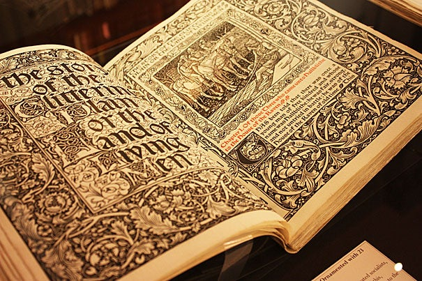 "A view of William Morris'  ""The Story of the Glittering Plain,"" ornamented with 23 pictures by Walter Crane (photo 1). This book is part of a new Houghton Library exhibit (photo 2) marking the 100th anniversary of the death of Crane, a Victorian-era illustrator of children's books (photo 3)."