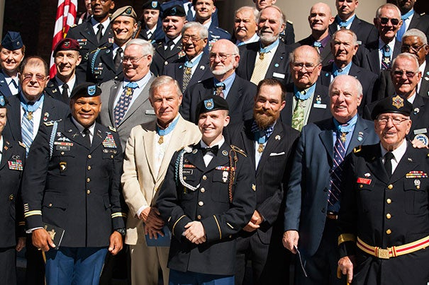 More than 40 of the 78 living recipients of the Congressional Medal of Honor gathered at the Memorial Church Friday for a private memorial service (photo 1). They were welcomed by Harvard veterans and ROTC members (photo 2). Thomas Reardon '68 (from left, photo 3), director of the Harvard Veterans Alumni Organization, stood as Harvard Kennedy School student Lt. Reuden Luoma-Overstreet greeted a veteran.