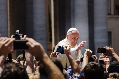 Pope Francis arrived Tuesday afternoon to begin his first U.S. tour. During the six-day visit, two Harvard Divinity School faculty will attend key events.