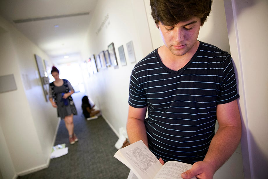 Sam Hagen '18 (right), a Theater, Dance, and Media concentrator, awaits his audition for Remo Airaldi's class. Stephanie Mitchell/Harvard Staff Photographer