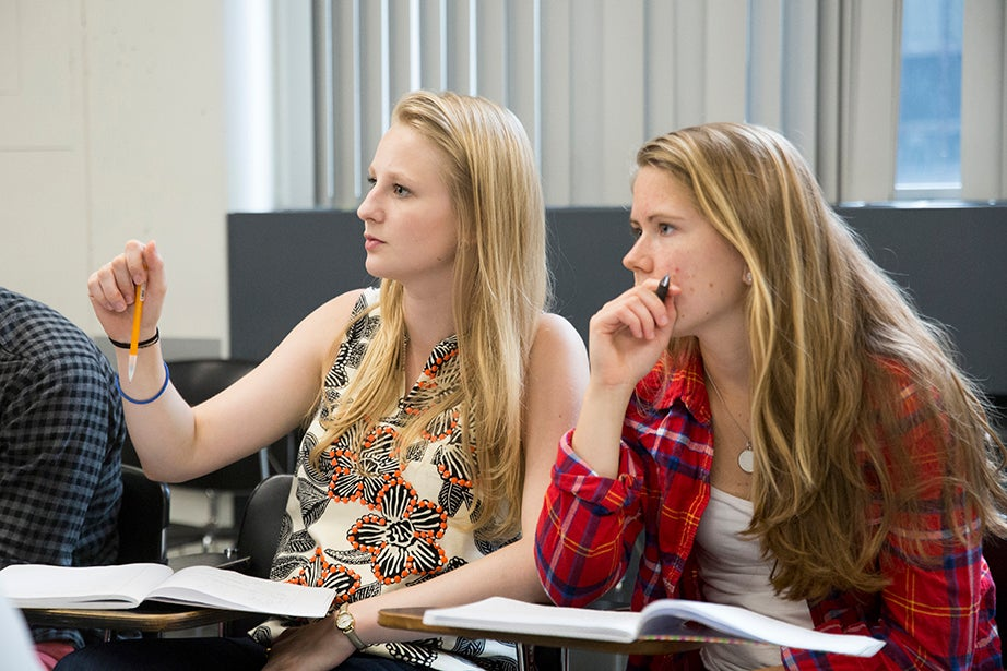 """Morgan Breitmeyer '17 (left) poses a question in """"Linear Algebra and Applications,"""" taught by Professor of Mathematics Michael Hopkins. Jon Chase/Harvard Staff Photographer"""