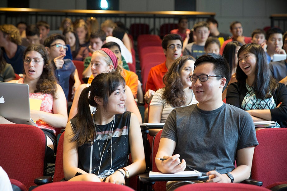 """Angela Yang '18 (left) attends """"Intermediate Microeconomics: Advanced,"""" taught by Fred and Eleanor Glimp Professor of Economics Edward Glaeser. Kris Snibbe/Harvard Staff Photographer"""