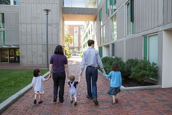 Adam Palmer, Research Fellow in Therapeutic Science, and his wife Sarah play with their children Lucinda, 5 1/2, Odessa, 3, and Everett, 1 1/2. The Graduate Commons Program has helped them adapt to campus living, allowing them to meet others, have playmates for their children, etc. Jon Chase/Harvard Staff Photographer