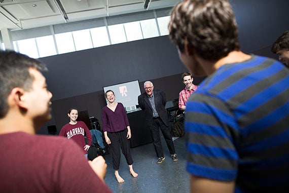 Visiting professor from the Yale University School of Drama David Chambers teaches a class as part of Harvard's new Theater, Dance & Media concentration. The class, including Julia Belanoff '18 (from left), Hanna Psychas '18, Chambers, and Alexander Iascone '16, participate in warm up exercises in Harvard's Farkas Hall.