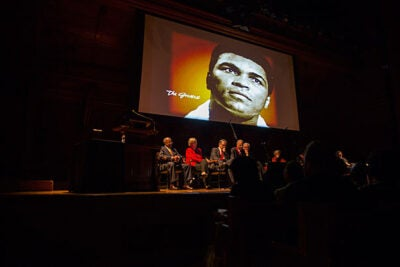 """Legendary boxer and activist Muhammad Ali was one of seven recipients of the W.E.B. Du Bois Medals. Other recipients included hip-hop artist Nasir """"Nas"""" Jones (photo 2) and journalist Charlayne Hunter-Gault (photo 3), who received a congratulatory kiss from Glenn H. Hutchins '77, J.D./M.B.A. '83."""