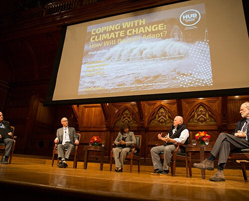 "A panel of experts examined ""Coping With Climate Change: How Will Boston Adapt?"" during a HUBweek event at Sanders Theatre. Moderating the talk was Harvard University Center for the Environment Director Daniel Schrag (from left). The panel included Carl Spector, Boston's director of climate and environmental planning; Atyia Martin, chief resilience officer for Boston; Robert Young, director of the Program for the Study of Developed Shorelines, Western Carolina University; and Harvard's James McCarthy, Agassiz Professor of Biological Oceanography."