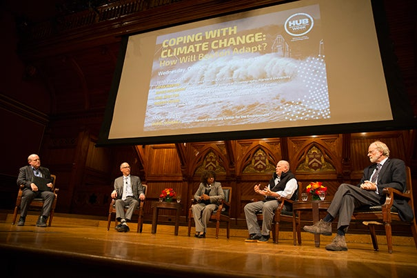 """A panel of experts examined """"Coping With Climate Change: How Will Boston Adapt?"""" during a HUBweek event at Sanders Theatre. Moderating the talk was Harvard University Center for the Environment Director Daniel Schrag (from left). The panel included Carl Spector, Boston's director of climate and environmental planning; Atyia Martin, chief resilience officer for Boston; Robert Young, director of the Program for the Study of Developed Shorelines, Western Carolina University; and Harvard's James McCarthy, Agassiz Professor of Biological Oceanography."""