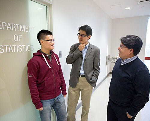 CDC data are considered something of a gold standard in disease surveillance, but it takes one to three weeks for reports to be compiled, making it hard for public health officials to stay ahead of the flu, said Samuel Kou (center), a professor of statistics. Kou worked with Shihao Yang (left) and Mauricio Santillana to deliver results in real time.