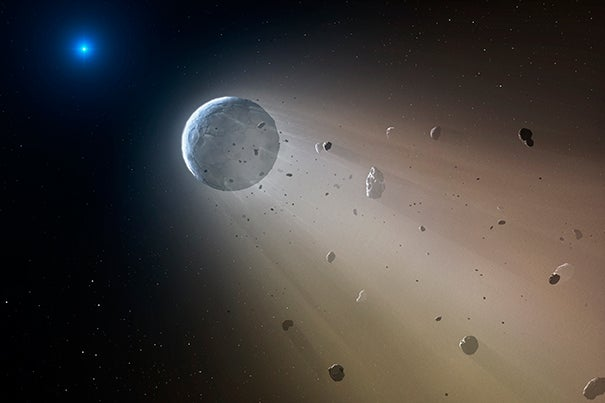 "In this artist's conception, a Ceres-like asteroid is slowly disintegrating as it orbits a white dwarf star. ""We now have a 'smoking gun' linking white dwarf pollution to the destruction of rocky planets,"" says Andrew Vanderburg of the Harvard-Smithsonian Center for Astrophysics. Within about a million years the object will be destroyed, leaving a thin dusting of metals on the surface of the white dwarf."
