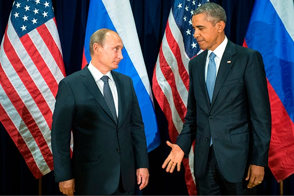 President Barack Obama and Russia's President Vladimir Putin posed for members of the media before a bilateral meeting at United Nations headquarters on Sept. 28. Putin caught many off-guard during the United Nations' General Assembly by announcing a new arrangement with Iraq, Iran, and Syria to share information in the fight against the Islamic State.