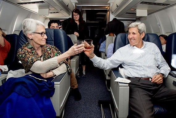 U.S. Department of State Secretary Kerry and Under Secretary Sherman Raise a Toast to Finalizing the Iran Nuclear Agreement as They Flew Home From Vienna Secretary Kerry and Under Secretary of State for Political Affairs Sherman share a toast of madeira wine – the same liquor the Founding Fathers used to toast the Declaration of Independence – as they flew home from Vienna, Austria, on July 14, 2015, after the E.U./P5+1/Iranian nuclear agreement was announced. [State Department photo/ Public Domain]