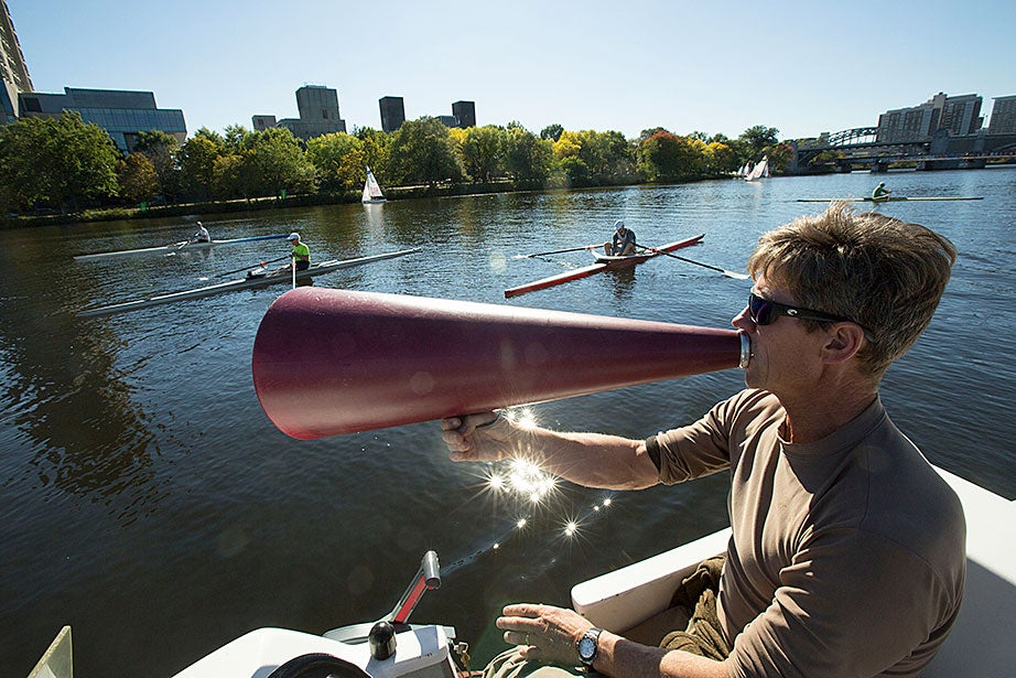 Dan Boyne, who has worked at the Weld Boathouse for 27 years, coaches athletes for the Head of the Charles Regatta.