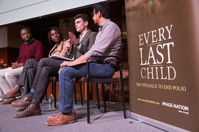 "A panel of faculty and students examined the efforts to make polio the second human disease to be eradicated. Speakers at ""Every Last Child"" included Osondu Ogbuoji (from left), Obiageli Okafor, Benjamin Ammon, and Usman Munir."