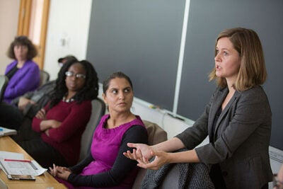 Adriana Zimova, J.D.'11, a human rights attorney from Slovakia and a Roma rights activist, spoke last week at Harvard Law School about the challenges of fighting human rights abuses against the Roma. Zimova was accompanied by fellow Roma rights activist Margareta Matache (pink shirt).