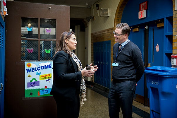 """Each year area leaders spend the day shadowing principals to """"get a firsthand look at the school-improvement investments the district has made and the challenges that remain."""" Edison K-8 School principal Sam Varano (left) speaks with  Paul Andrew, vice president of Harvard Public Affairs and Communications. Andrew spent the day getting to know students at Edison K-8."""