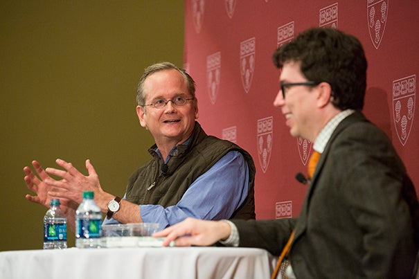"Harvard Law School Professor Lawrence Lessig (left) shared what he learned from his failed presidential bid during a conversation with colleague Jonathan Zittrain. ""Money has corrupted our political process,"" said Lessig."