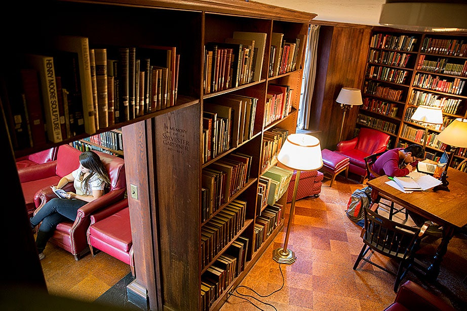 Brenda Serpas '16 (left) and Chris Zhang '18 study in the Eliot House library.