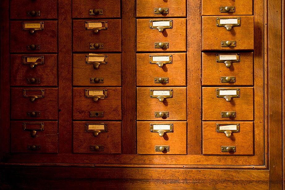Oak card catalogs line the Adams House library.