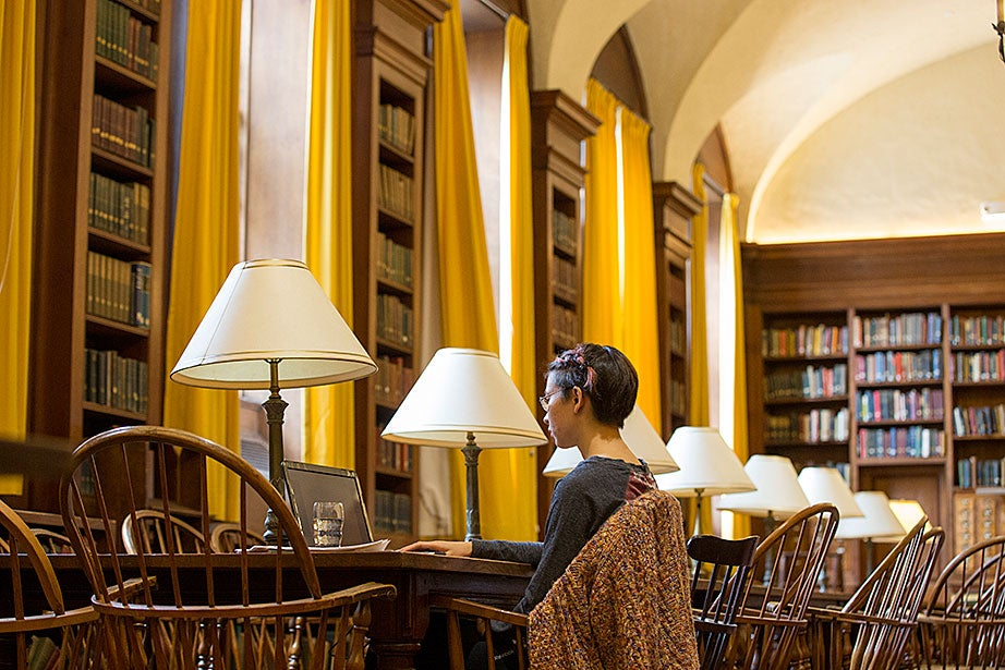 Ariana Chaivaranon '18 preps for back-to-back midterms inside the Adams House library.