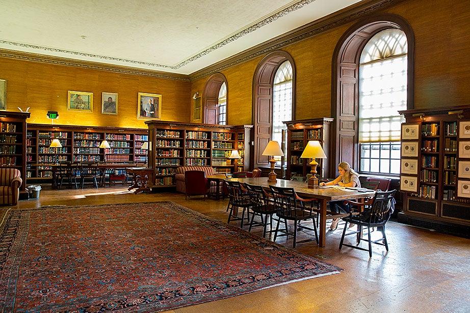 Elizabeth Koch '18 studies inside the Eliot House library.