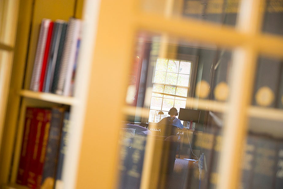 Taylor Carol '17, studying for his English class inside Cabot's library, removed the desk in his room for more space.