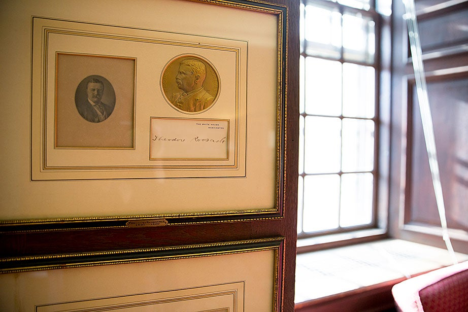 The presidential coin collection in the Eliot House library includes one of Theodore Roosevelt.